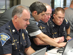 Police officers work with a JTAC developer to test the eCWS system and provide feedback about the equipment, the online application and the tickets it produces.
