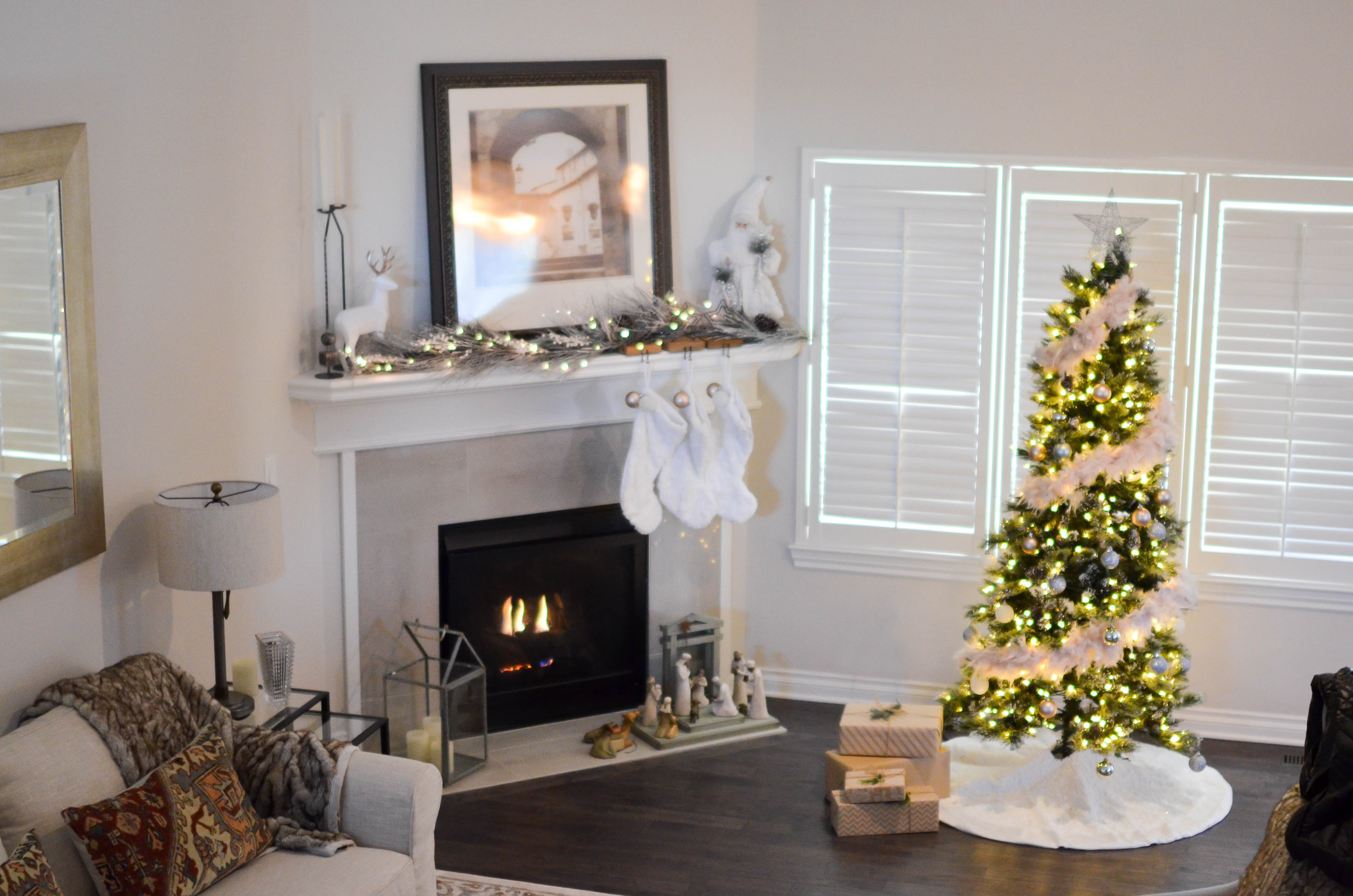 Christmas decorated room with tree, tinsel and fireplace