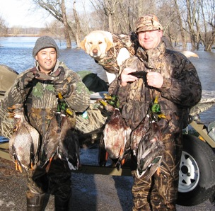 Two duck hunters and a dog