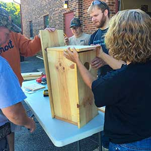 Volunteers building bird houses