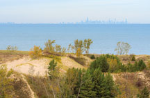 The Chicago skyline along the shore of Lake Michigan as seen from atop a dune along Paul H. Douglas Trail.