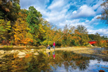 Boys enjoy the splendor of fall along Sugar Creek at Shades State Park