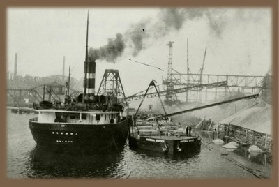 Historic picture, view of vessel's stern, unloading gravel cargo, circa 1930-1935.Used with permission, Great Lakes Marine Collection of the Milwaukee Public Library / Milwaukee Public Library.
