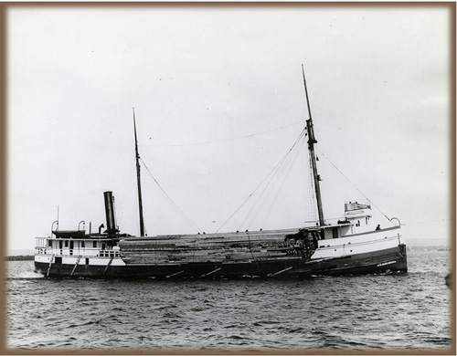 View of vessel's starboard side with cargo of lumber, circa 1908. Used with permission, Great Lakes Marine Collection of the Milwaukee Public Library / Milwaukee Public Library