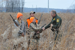 Hunters with an Indiana Conservation Officer