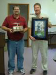 Chris Hostettler accepts an award from Division of Reclamation Director Bruce Stevens