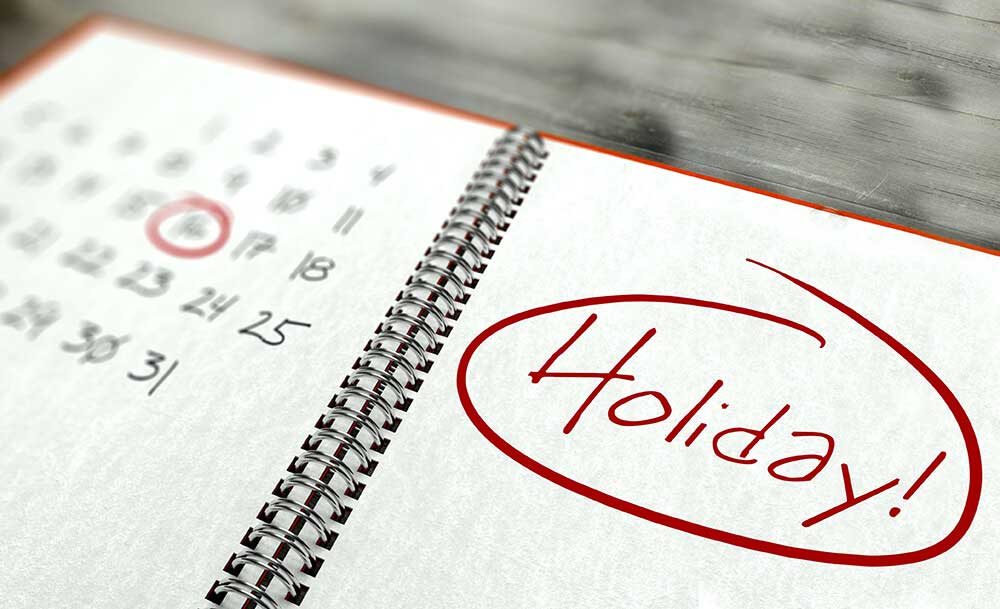 Holiday image. Picture of a calendar in a notebook with a holiday circled