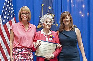 Photo of Dorothy Kessner receiving the award