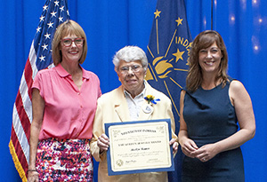 Photo of Marilyn Skinner receiving the award