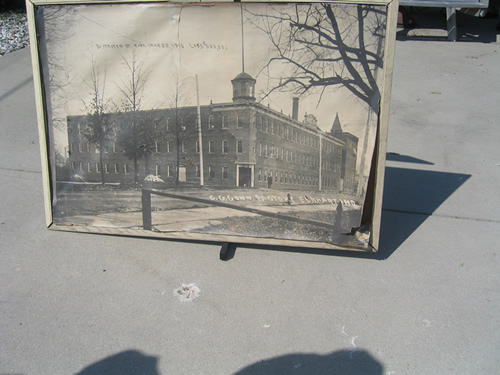 This large photograph is of the original Conn factory that stood on this site.