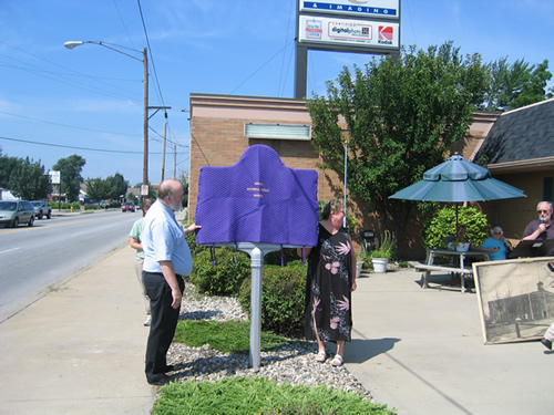 The C. G. Conn Company marker stands at the NW corner of Jackson Blvd. and Elkhart Avenue in Elkhart.