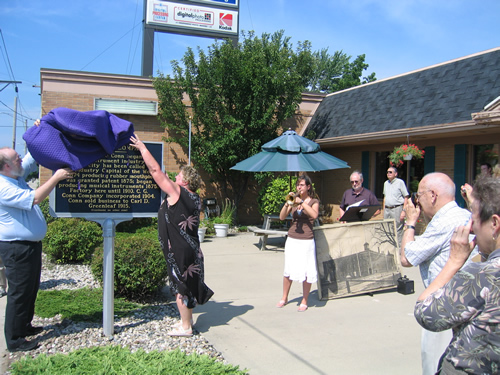 Dale and Pam Longacre, owners of the Elkhart Camera Center, which now stands on the site of the old Conn factory, had the honor of unveiling the marker, while daughter Tiffany played the National Anthem on an original 1880s Conn's coronet.