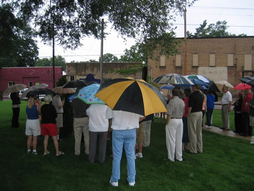 Despite the weather, about forty people attended the dedication ceremony.