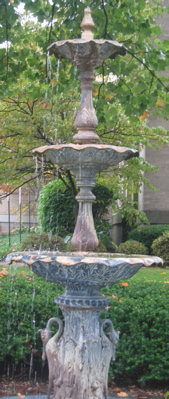 One of the two tall crane fountains that adorn the front lawn of the library.