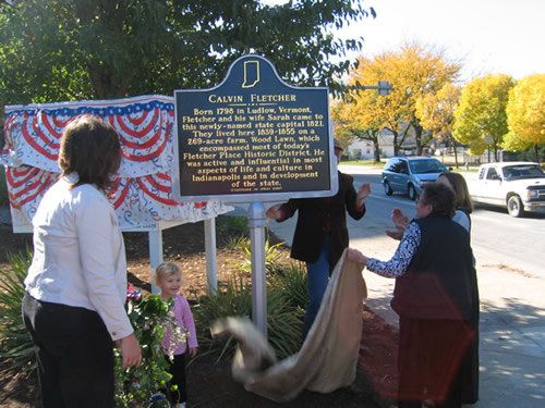 One of Fletcher's descendants unveils the marker.