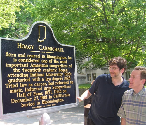 Bloomington City Councilman Steve Volan and Bloomington Mayor Mark Kruzan read the marker.