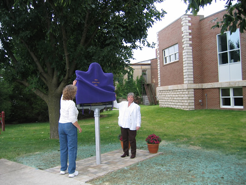 Paula Bongen, IHB, and Katherine Taul, Executive Director of the Ripley County Tourism Bureau unveil the O & M marker.