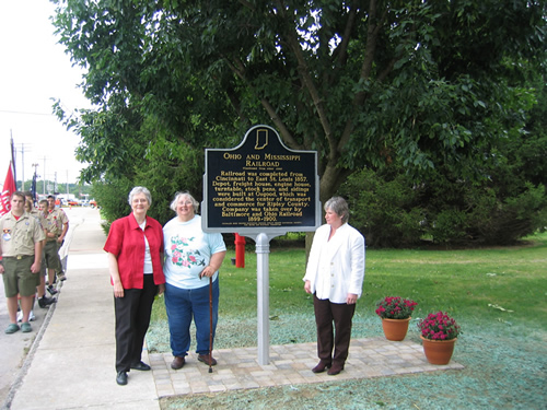 Standing with Paula Bongen is Helen Todd Einhaus, historian for Ripley County and historian Diane Perrine Coon.