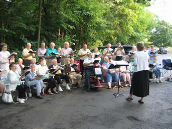 'Gathering Music,' a group of local singers, provided entertainment for the dedication.