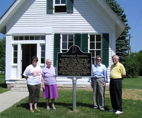 (From left) Carrie Mugford, City Clerk Treasurer; Ferne Baldwin, expert on the Thomas Riley Marshall birth home; Pamela Bennett, Director of the Indiana Historical Bureau; and William Eberly, President of the North Manchester Historical Society and marker applicant with the marker.