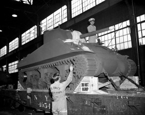 Carefully loading the M-4 Tank onto a rail car.