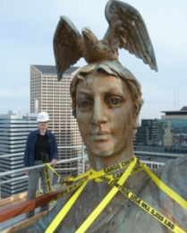 Victoria Emery measures up to Victory sculpture. Courtesy Arsee Engineers