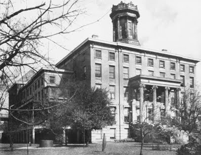 Black and white photo of old school downtown